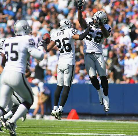 ORCHARD PARK, NY - SEPTEMBER 18:  Stanford Routt #26 and  Quentin Groves #52 of the Oakland Raiders celebrate Routt's interception in the first half against the Buffalo Bills at Ralph Wilson Stadium on September 18, 2011 in Orchard Park, New York.  (Photo by Rick Stewart/Getty Images) Photo: Rick Stewart, Getty Images