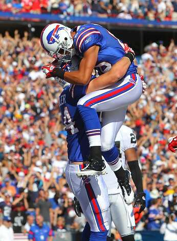 ORCHARD PARK, NY - SEPTEMBER 18: Scott Chandler #84 of the Buffalo Bills celebrates his touchdown with David Nelson #86 during an NFL game against the Oakland Raiders at Ralph Wilson Stadium on September 18, 2011 in Orchard Park, New York. (Photo by Tom Szczerbowski/Getty Images) Photo: Tom Szczerbowski, Getty Images