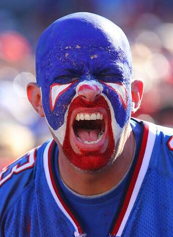 ORCHARD PARK, NY - SEPTEMBER 18: A fan of the Buffalo Bills cheers during an NFL game against the Oakland Raiders at Ralph Wilson Stadium on September 18, 2011 in Orchard Park, New York. (Photo by Tom Szczerbowski/Getty Images) Photo: Tom Szczerbowski, Getty Images