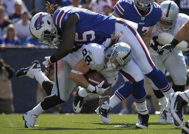 Oakland Raiders' Nick Miller (88) is tackled by Buffalo Bills' Kelvin Sheppard (55) during the third quarter of an NFL football game in Orchard Park, N.Y., Sunday, Sept. 18, 2011. (AP Photo/Derek Gee) Photo: Derek Gee, AP