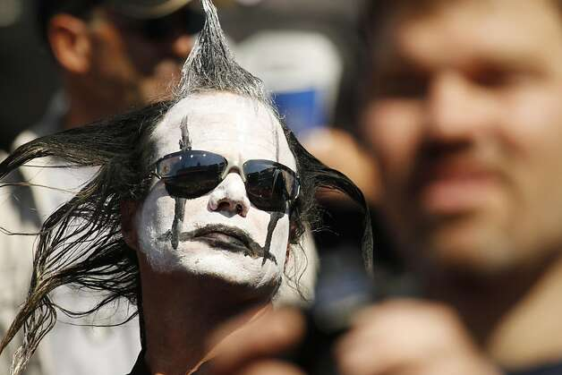 An Oakland Raiders fan in the stands during warmups before an NFL football game against the Buffalo Bills in Orchard Park, N.Y., Sunday, Sept. 18, 2011. (AP Photo/Derek Gee) Photo: Derek Gee, AP