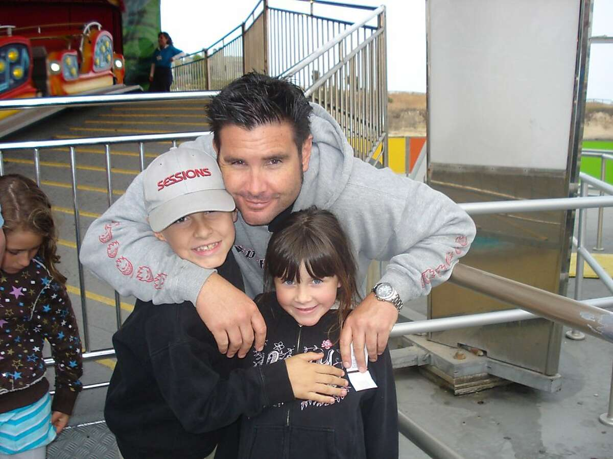 This undated image provided Tuesday April 5, 2011 by John Stow shows Bryan Stow holding his 12-year-old son and 8-year-old daughter. Bryan Stow, A Giants fan was beaten after last week Dodger home opener, has sustained brain damage as a result and remains in critical condition. The children are unidentified at the request of the source. (AP Photo/John Stow) Ran on: 04-11-2011 Photo caption Dummy text goes here. Dummy text goes here. Dummy text goes here. Dummy text goes here. Dummy text goes here. Dummy text goes here. Dummy text goes here. Dummy text goes here.###Photo: rivalry11_PH1_stow1214352000John Stow###Live Caption:This undated image provided Tuesday April 5, 2011 by John Stow shows Bryan Stow holding his 12-year-old son and 8-year-old daughter. Bryan Stow, A Giants fan was beaten after last week Dodger home opener, has sustained brain damage as a result and remainsin critical condition. The children are unidentified at the request of the source.###Caption History:This undated image provided Tuesday April 5, 2011 by John Stow shows Bryan Stow holding his 12-year-old son and 8-year-old daughter. Bryan Stow, A Giants fan was beaten after last week Dodger home opener, has sustained brain damage as a result and remains in critical condition. The children are unidentified at the request of the source. (AP Photo-John Stow)###Notes:Bryan Stow###Special Instructions:THE CHILDREN ARE UNIDENTIFIED AT THE REQUEST OF THE SOURCE, UNDATED IMAGE PROVIDED BY JOHN STOW. NO SALES. AP provides access to this publicly distributed HANDOUT photo to be used only to illustrate news reporting or commentary on the facts or events depi Ran on: 04-11-2011 Photo caption Dummy text goes here....