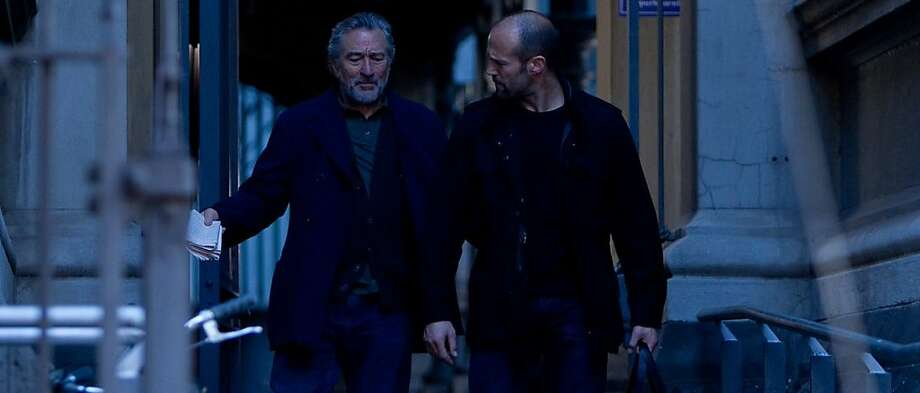 Robert De Niro (L) and Jason Statham (R) star in KILLER ELITE, opening nationwide September 23rd. Based on a true story, KILLER ELITE is the action-packed account of an ex special ops agent (Jason Statham) who must evade a cunning assassin (Clive Owen) to rescue his mentor (Robert De Niro). Photo: Dan Smith, Open Road Films