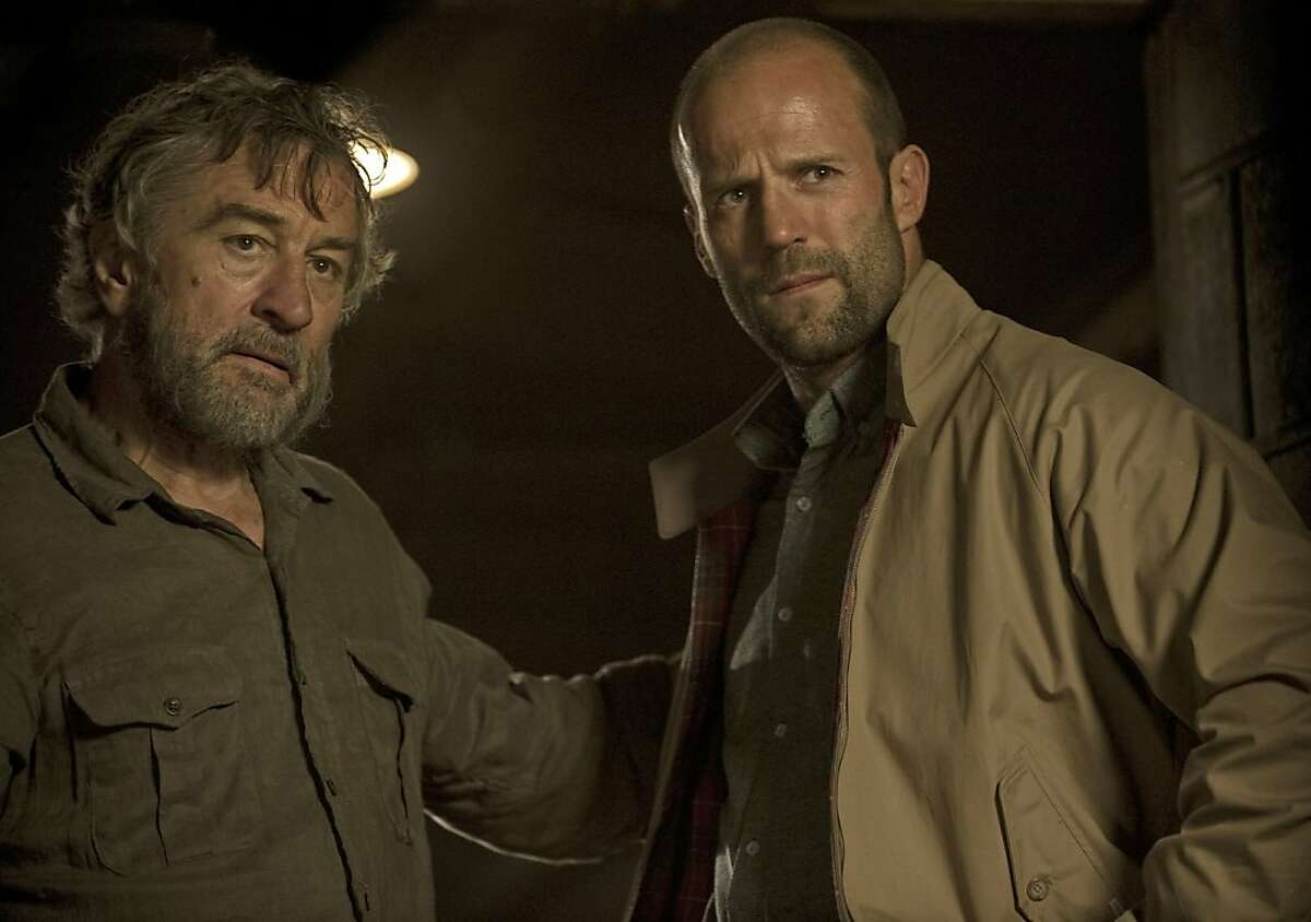 In this film image released by Open Road Films, Robert De Niro , left, and Jason Statham are shown in a scene from