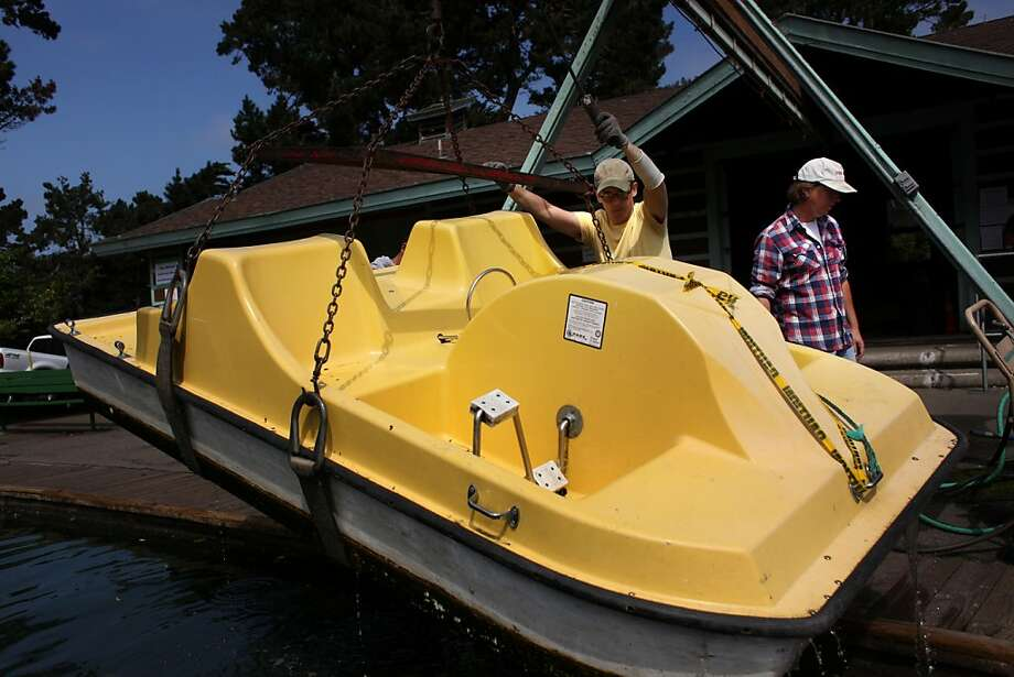Jon Luckenoff, asst. manager, and Jeff Fones, manager of the Stowe Lake Boat House in Golden Gate park, haul a paddle boat out of the lake on Monday Sep. 12, 2011 in San Francisco, Calif. The snack bar/boat rental venue has eight days to move their stuff out of the building after 68 years of business. Photo: Mike Kepka, The Chronicle