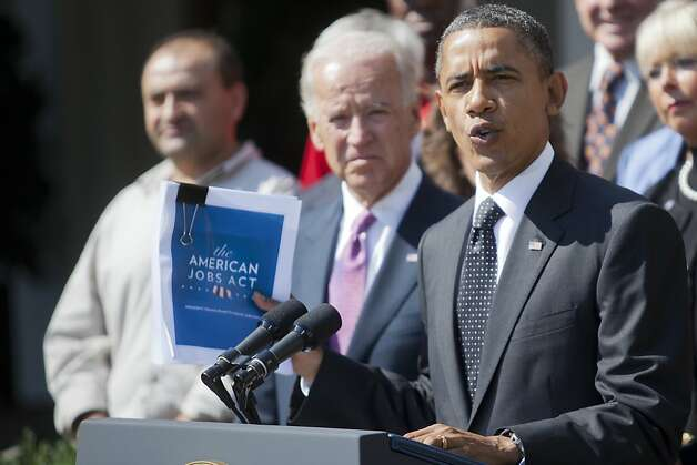 President Barack Obama holds a copy of the American Jobs Act while announcing he is sending the $447 billion jobs package, his plan to create job growth, to Congress today, in the Rose Garden of the White House in Washington, Sept. 12, 2011. Flanked by people from across the country who he said would be helped by the law if it passes, and Vice President Joseph Biden, left, Obama reiterated his jobs speech from last Thursday. (Philip Scott Andrews/The New York Times)  Ran on: 09-18-2011 President Obama is long on rhetorical style and analysis but woefully short on substance with his American Jobs Act. Ran on: 09-18-2011 President Obama is long on rhetorical style and analysis but woefully short on substance with his American Jobs Act. Photo: Philip Scott Andrews, The New York Times