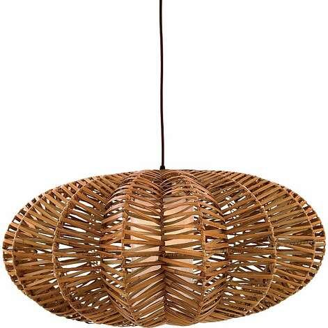 Pendant orbs cast warm light on rattan sfgate for Ikea orb light