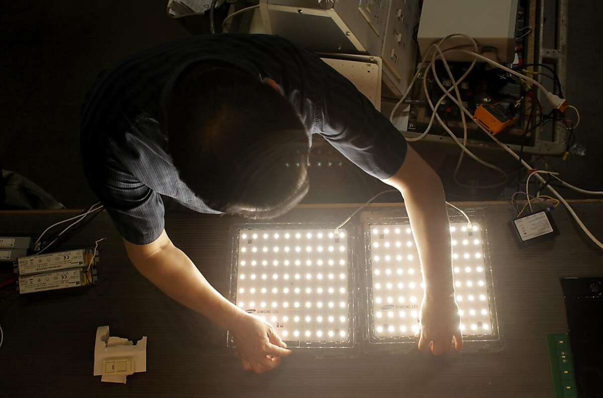 Chuan Li tests the 40 LED panels which are designed by Finelite, Thursday September 22, 2011, in Union City, Calif. Finelite is a recipient of a state program known as PIER, Public Interest Energy Research. This program is set to end in January as the state lawmakers did not vote to extend its life.