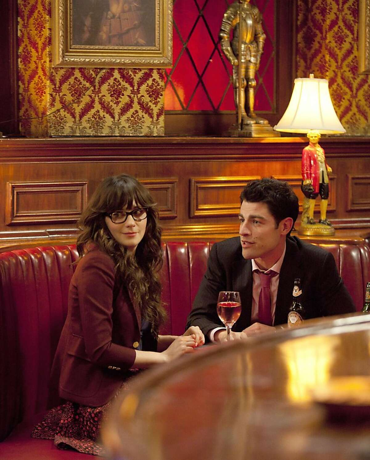 NEW GIRL: Schmidt (Max Greenfield, R) gives Jess (Zooey Deschanel, L) advice in the series premiere of NEW GIRL airing Tuesday, Sept. 20 (9:00-9:30 PM ET/PT) on FOX.