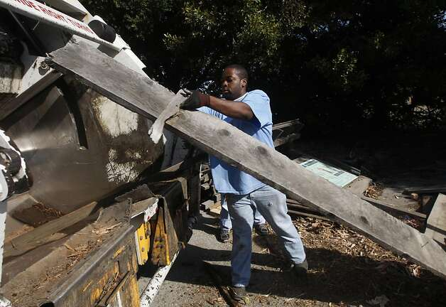 Zachariah Jefferson loads driftwood into a garbage truck at the annual coastal cleanup near Candlestick Park in San Francisco, Calif. on  Saturday, Sept. 17, 2011. Photo: Paul Chinn, The Chronicle
