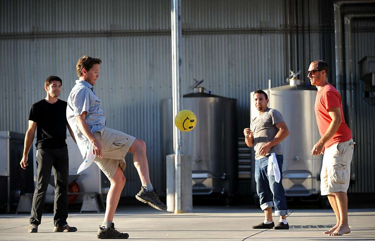 Winemaker Wells Guthrie playing soccer with (from L to R) intern Florent Dauvissat, cellar master Alejandro Valencia and assistant wine maker Mike Lucia at Copain Winery in Healdsburg. September 3, 2011.