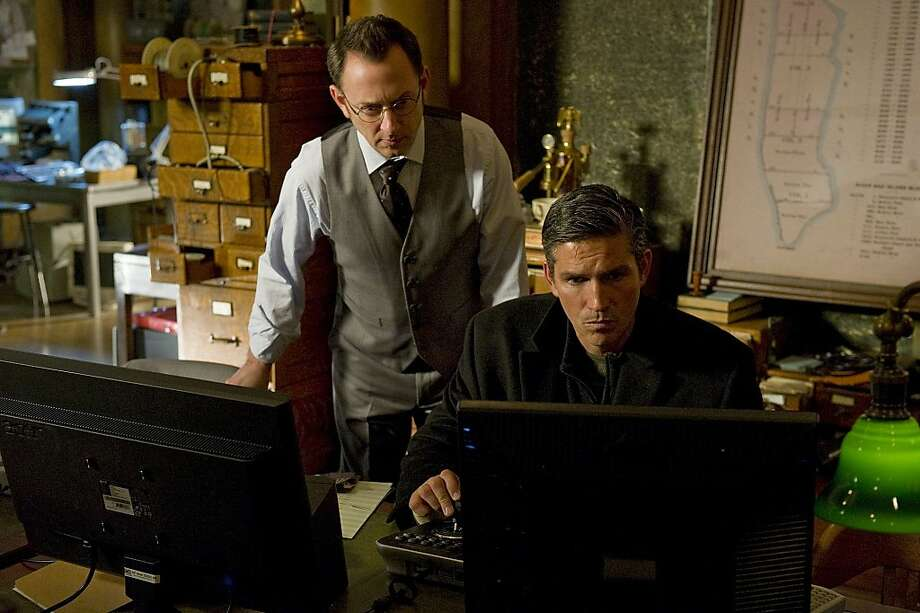 PERSON OF INTEREST is a crime thriller from J.J. Abrams about a presumed dead former-CIA agent who teams up with a mysterious billionaire to prevent violent crimes by using state-of-the-art technology and their own brand of vigilante justice. James Caviezel m(right) stars as Reese, who is specially trained in covert operations, and Michael Emerson (left) stars as Finch, the wealthy software genius who invented a program that can identify people about to be involved in violent crimes. PERSON OF INTEREST will premiere this Fall, Thursday Sept. 22 (9:00-10:00 PM ET/PT) on the CBS Television Network. Photo: Jeffrey R Staab, CBS