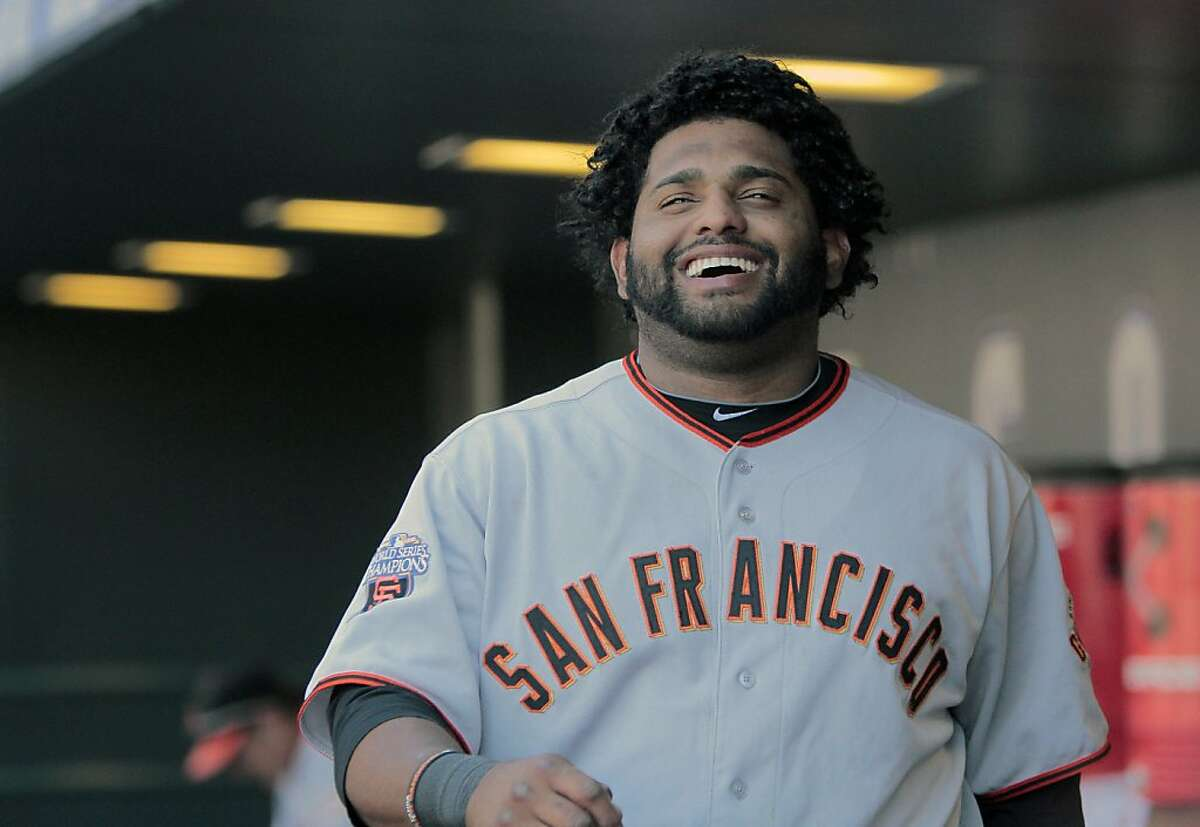 San Francisco Giants' Pablo Sandoval (48) enjoys the 12-5 victory over the Colorado Rockies during the eight inning of a baseball game Sunday, Sept. 18, 2011 in Denver. Sandoval went three for four with four RBI. (AP Photo/Barry Gutierrez)