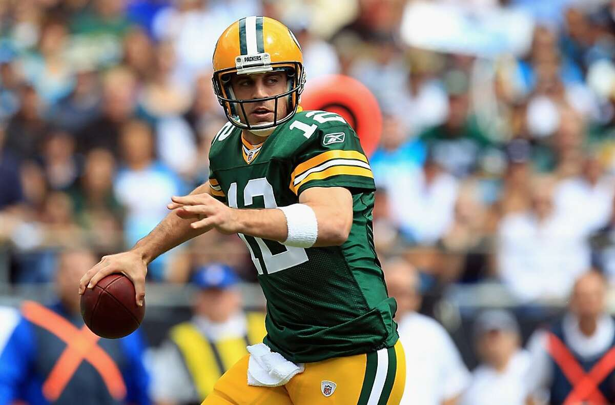 CHARLOTTE, NC - SEPTEMBER 18: Aaron Rodgers #12 of the Green Bay Packers drops back to pass against the Carolina Panthers during their game at Bank of America Stadium on September 18, 2011 in Charlotte, North Carolina. (Photo by Streeter Lecka/Getty Images)