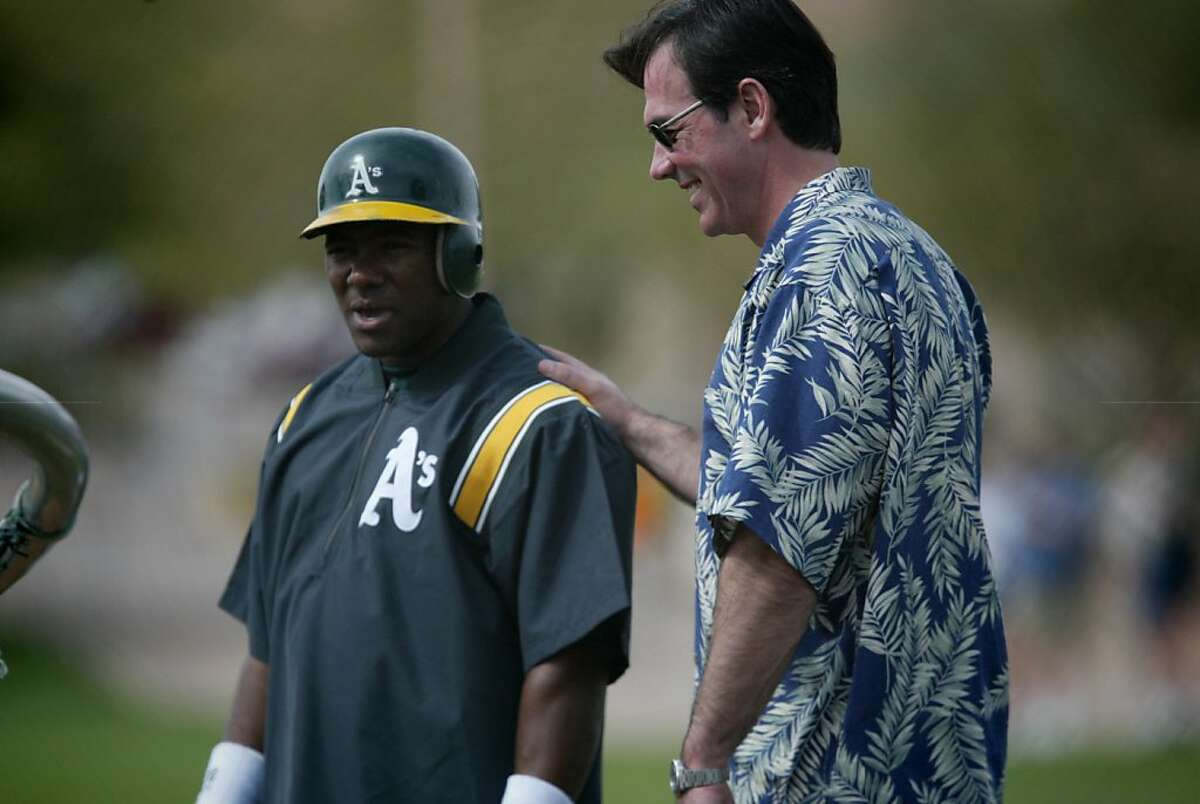 ATHLETICS7-C-05MAR02-SP-DF Billy Beane talks with Miquel Tejada at Oakland A's spring training at Phoenix, Arizona. CHRONICLE PHOTO BY DEANNE FITZMAURICE Ran on: 09-18-2011 As GM Billy Beane talked with Miguel Tejada at spring training in the Moneyball season, 2002. Tejada would become MVP, yet receive little mention in Michael Lewis book. Ran on: 09-18-2011 As GM Billy Beane talked with Miguel Tejada at spring training during the Moneyball season, 2002. Tejada would become MVP, yet he received little mention in Michael Lewis book.