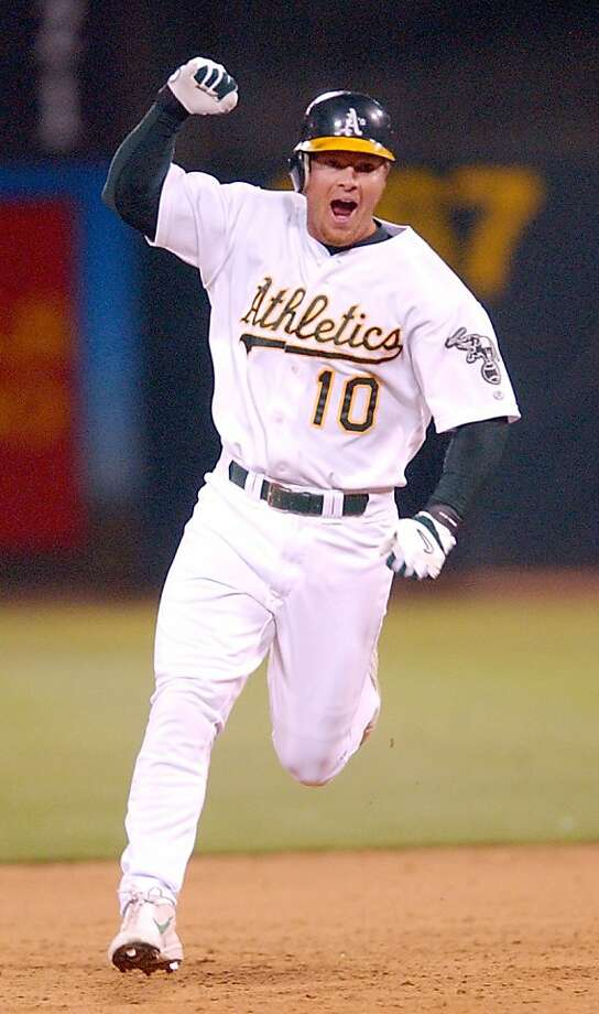 Oakland Athletics' Scott Hatteberg celebrates after hitting a game-winning pinch hit home run against the Kansas City Royals during the ninth inning at the Network Associates Coliseum in Oakland, Calif. on September 4, 2002.  The Athletics won their 20th straight game, breaking the American League record for most consecutive wins.  REUTERS/Justin Sullivan ALSO Ran on: 08-31-2008   Ran on: 09-18-2011 Scott Hatteberg , prominent in the book, homered to give A's a 20th straight win. Ran on: 09-18-2011 Scott Hatteberg, prominent in the book, homered to give A's a 20th straight win. Photo: Str, REUTERS