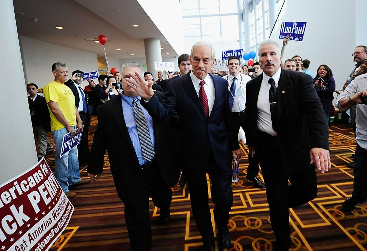 LOS ANGELES, CA - SEPTEMBER 17: Republican presidential candidate Rep. Ron Paul (R-TX) (C) is escorted to a ballroom to speak to his supporters during the California Republican Party Convention on September 17, 2011 in Los Angeles, California. The three-day California Republican Party 2011 Fall Convention began yesterday with an appearance by Republican presidential candidate Rep. Michele Bachmann (R-MN). (Photo by Kevork Djansezian/Getty Images)