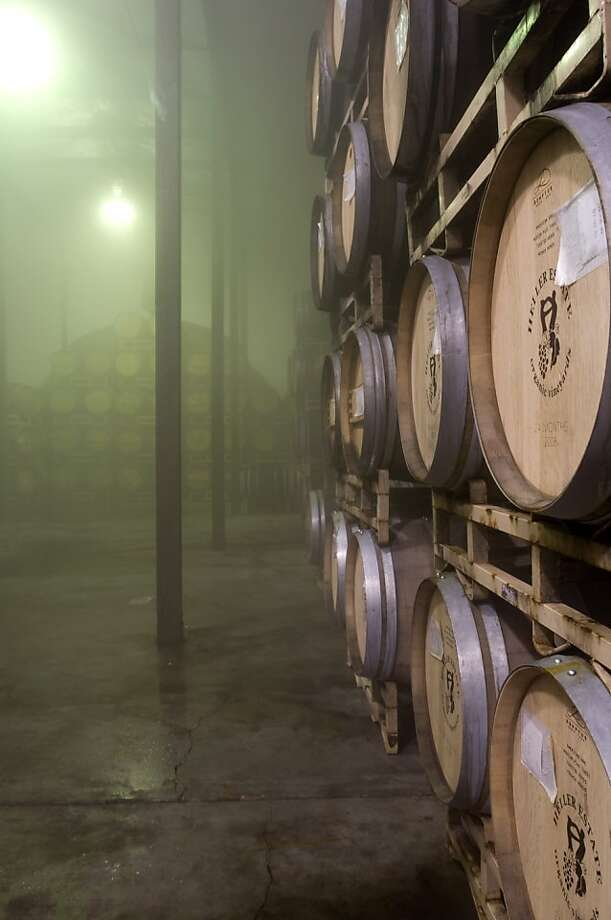 The barrel room at Heller Estates winery is kept very humid through a humidifier in order to keep the wine from evaporating through the breathable barrels and is seen in Carmel Valley, Calif., on Wednesday, September 8, 2010. Photo: Chad Ziemendorf, The Chronicle