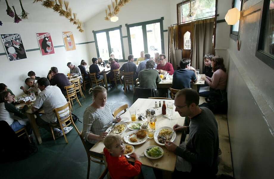 (filename)  Octoberfest What's New.  Suppenkuche is bustling at a brunch Sunday morning...great German food says the family in the foreground.  (date) (photographer)  Ran on: 10-13-2004 Oktoberfest is on tap at Suppenkuche in San Francisco. This month, many Bay Area restaurants are offering specials on bratwurst and Pilsner, often throwing live music and folk dancing into the mix.  Ran on: 10-13-2004 Oktoberfest is on tap at Suppenkuche in San Francisco. This month, many Bay Area restaurants are offering specials on German food and beer, often throwing live music and folk dancing into the mix. ALSO Ran on: 03-22-2007 Suppenkuche serves big portions of hearty German fare at dinner nightly. At Sunday brunch (shown here) the menu includes bratwurst, potato pancakes, gravlax and musli with quark. Ran on: 03-22-2007  Ran on: 03-06-2008 Suppenkuche serves big portions of hearty German fare for dinner in a boisterous setting on San Francisco's Hayes Street. At a Sunday brunch like this one, you might order bratwurst, potato pancakes, gravlax and musli with quark. And, of course, don't forget about the beer. Photo: Brant Ward, SFC