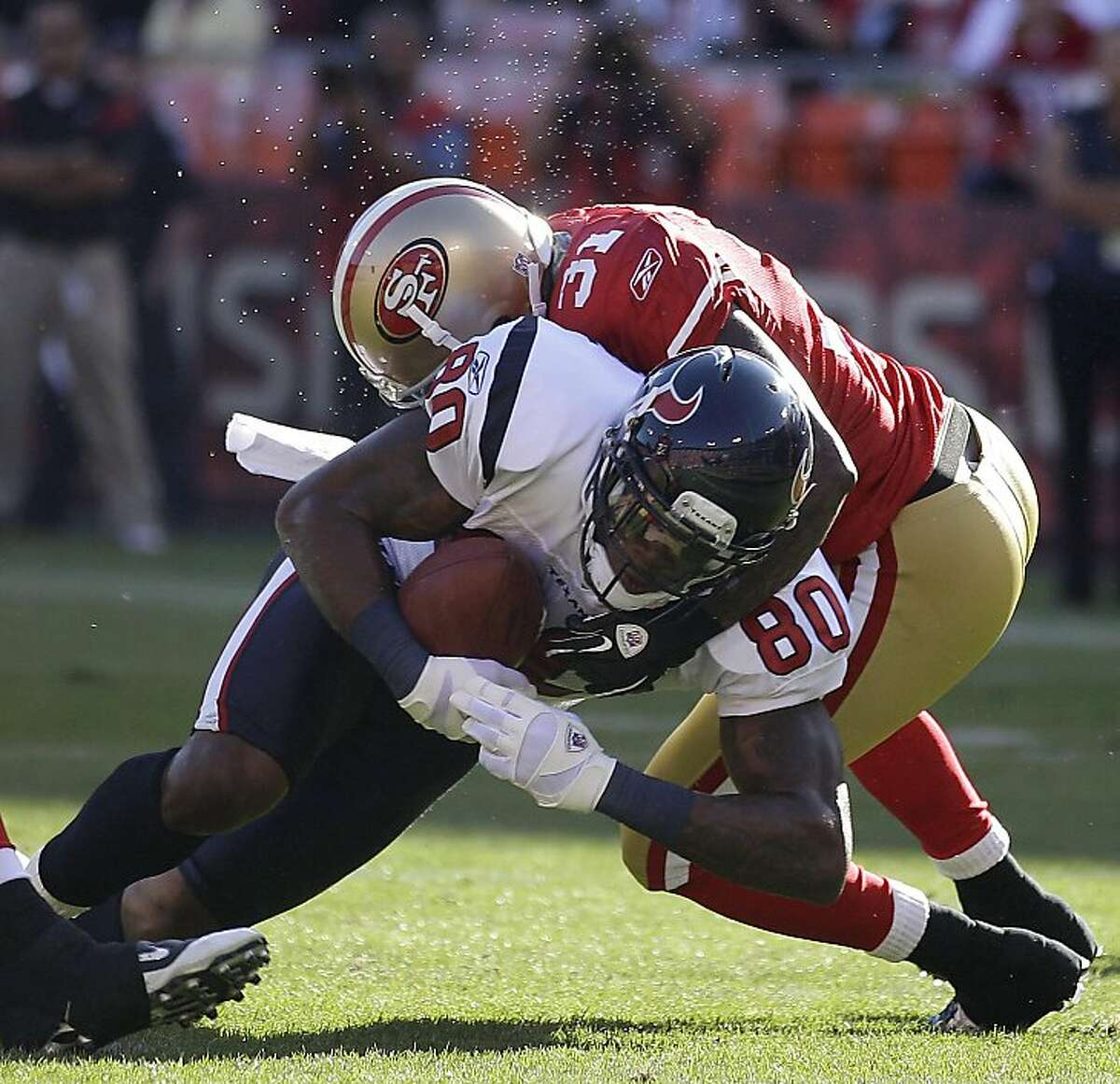 Houston Texans wide receiver Andre Johnson (80) is tackled by San Francisco 49ers safety Donte Whitner (31) in the first half of a preseason NFL football game in San Francisco, Saturday, Aug. 27, 2011. (AP Photo/Marcio Jose Sanchez)