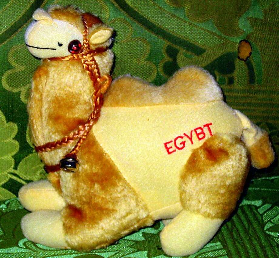 Millions of people have visited Egypt, but how many can say they?ve been to Egybt?  When moved, this adorable camel also plays a catchy arabic jingle and nearly synchronizes it with illuminated flashing red eyes. Photo: Matthew Brown, CrapSouvenirs.com