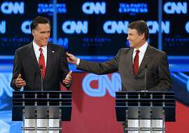 Former Massachusetts Gov. Mitt Romney, left, and Texas Gov. Rick Perry during a Republican debate Tuesday, Sept. 13, 2011, in Tampa, Fla. (AP Photo/Mike Carlson)