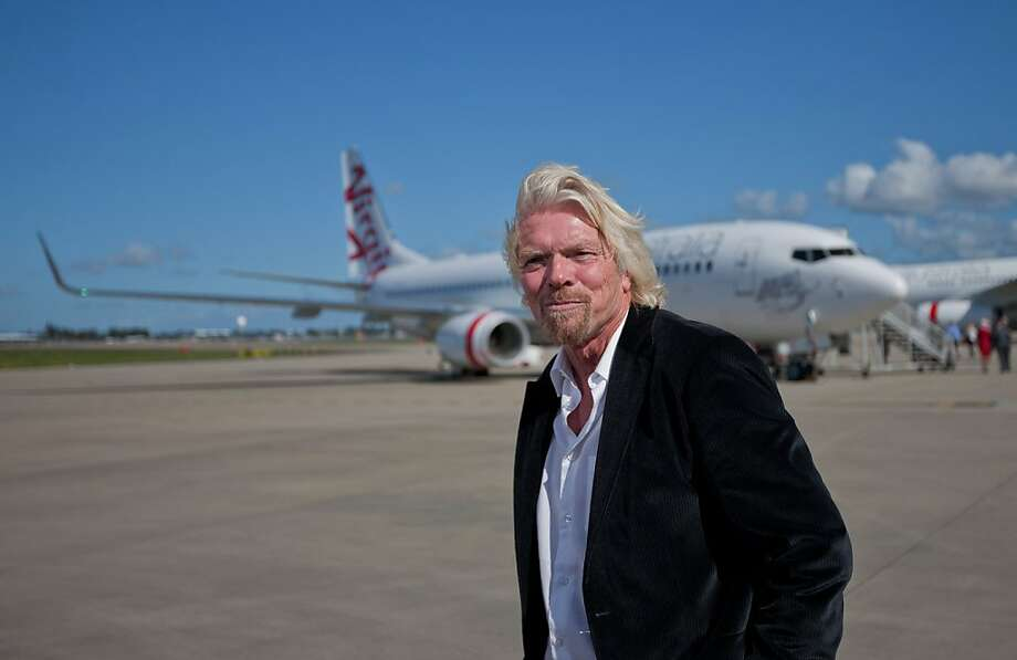 Richard Branson, chairman and founder of Virgin Group Ltd., poses for the media after arriving in an A330 passenger jet for the unveiling of the new face of the Virgin Blue Group of airlines, in Sydney, Australia, on Wednesday, May 4, 2011. Virgin Blue Holdings, the Australian carrier backed by Branson, began flying under the name Virgin Australia, as it tries to break Qantas Airways Ltd.'s hold on the nation's business-travel market. Photographer: Ian Waldie/Bloomberg Richard Branson, chairman and founder of Virgin Group Ltd., poses for the media after arriving in an A330 passenger jet for the unveiling of the new face of the Virgin Blue Group of airlines, in Sydney, Australia, on Wednesday, May 4, 2011. Virgin Blue Holdings, the Australian carrier backed by Branson, began flying under the name Virgin Australia, as it tries to break Qantas Airways Ltd.'s hold on the nation's business-travel market. Photographer: Ian Waldie/Bloomberg *** Local Caption *** Richard Branson Photo: Ian Waldie, Bloomberg