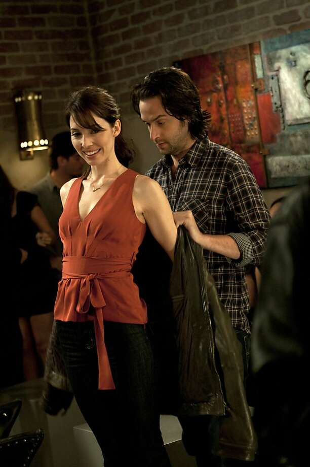 "WHITNEY -- ""First Date"" Episode 102 -- Pictured: (l-r) Whitney Cummings as Whitney, Chris D'Elia as Alex. Photo: Neil Jacobs, NBC"