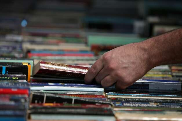 Russ Carlson of San Francisco pulls a book out of a row of books on a table at the Friends of the San Francisco Public Libraryês special 50th Anniversary book sale at Fort Mason in San Francisco, Calif., Thursday, April 21, 2011.  Ran on: 04-23-2011 Photo caption Dummy text goes here. Dummy text goes here. Dummy text goes here. Dummy text goes here. Dummy text goes here. Dummy text goes here. Dummy text goes here. Dummy text goes here.###Photo: booksale23_PH11303171200SFC###Live Caption:Russ Carlson of San Francisco pulls a book out of a row of books on a table at the Friends of the San Francisco Public Libraryês special 50th Anniversary book sale at Fort Mason in San Francisco, Calif., Thursday, April 21, 2011.###Caption History:Russ Carlson of San Francisco pulls a book out of a row of books on a table at the Friends of the San Francisco Public Library Ran on: 09-21-2011 Books  --  remember those?  --  are on sale at Fort Mason Center. Ran on: 09-21-2011 Books  --  remember those?  --  are on sale at Fort Mason Center. Ran on: 09-21-2011 Books  --  remember those?  --  are on sale at Fort Mason Center. Ran on: 09-21-2011 Books  --  remember those?  --  are on sale at Fort Mason Center. Ran on: 09-21-2011 Books  --  remember those?  --  are on sale at Fort Mason Center. Ran on: 09-21-2011 Books  --  remember those?  --  are on sale at Fort Mason Center. Ran on: 09-21-2011 Books  --  remember those?  --  are on sale at Fort Mason Center. Ran on: 09-21-2011 Books  --  remember those?  --  are on sale at Fort Mason Center. Photo: Lea Suzuki, The Chronicle