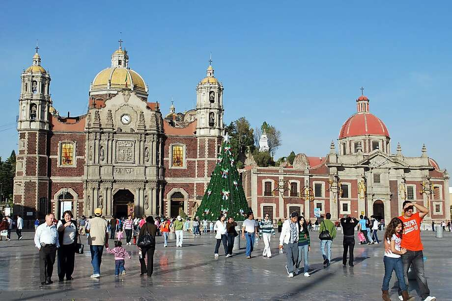 Mexico City dresses up for the holidays. The plaza in front of the old Basilica of Our Lady of Guadalupe sports a Christmas tree Photo: Rick Steves, Ricksteves.com