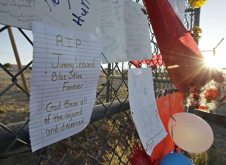 A sign is left at a memorial near the entrance of an airport in Reno, Nev., Monday, Sept. 19, 2011, where the Reno Air Races were held. The Reno Air Races were canceled after pilot Jimmy Leeward's plane crashed on Friday. Several people were killed, including Leeward, and dozens more were inured. (AP Photo/Paul Sakuma) Photo: Paul Sakuma, AP