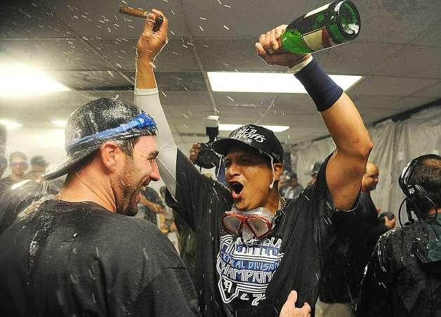 OAKLAND, CA - SEPTEMBER 16: Victor Martinez (L) and Justin Verlander (R) celebrate in the locker room after winning the American League Central division in a game against the Oakland Athletics 3-1 at O.co Coliseum on September 16, 2011 in Oakland, California.  (Photo by Thearon W. Henderson/Getty Images) Photo: Thearon W. Henderson, Getty Images
