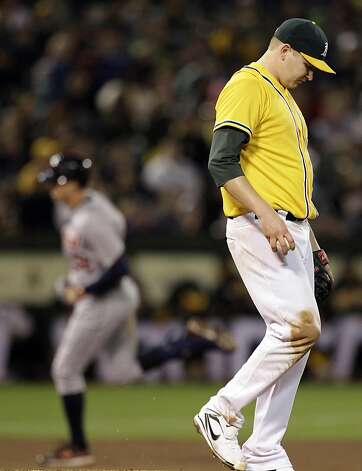 Oakland Athletics' Trevor Cahill, right, turns his back after giving up a home run to Detroit Tigers' Don Kelly, left, in the seventh inning of a baseball game, Friday, Sept. 16, 2011, in Oakland, Calif. (AP Photo/Ben Margot) Photo: Ben Margot, AP