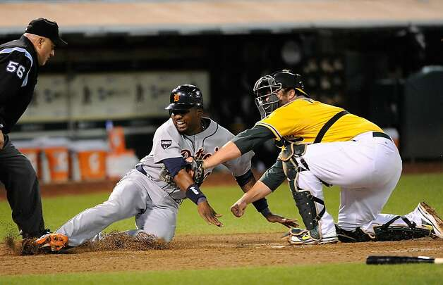 OAKLAND, CA - SEPTEMBER 16: Wilson Betemit #20 of the Detroit Tigers is tagged out at home plate by Landon Powell #11 of the Oakland Athletics in the six inning during an MLB baseball game at O.co Coliseum on September 16, 2011 in Oakland, California.  (Photo by Thearon W. Henderson/Getty Images) Photo: Thearon W. Henderson, Getty Images