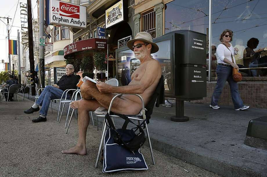 George Davis, enjoys the weather while in the nude near a parklet at the corner of 17th street and Castro in San Francisco, Ca. , on Tuesday September 6, 2011. Since it really hasn't been a crime to walk around nude in the city, at the very least these naked folks could put a cover on chairs when they dine and put a few clothes on too, at least that's what Supervisor Scott Wiener is proposing with new legislation that he will introduce at the Board of Supervisors today. Photo: Michael Macor, The Chronicle