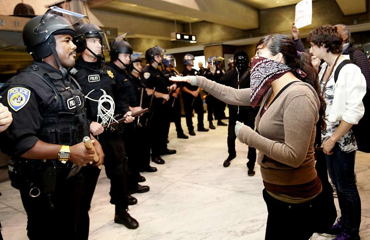 Protestors confront police at the Embarcadero station during a BART protest in San Francisco, Calif., Monday, August 29, 2011.