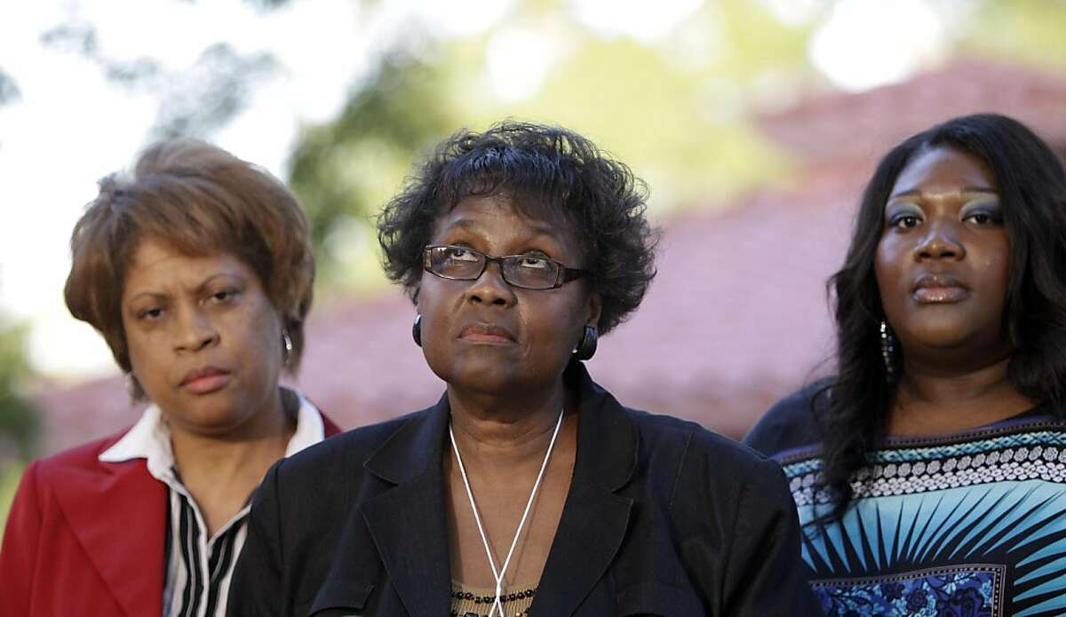 Clara Taylor, center, looks up to the sky as she answers a question as her her daughter, Tiffany, right, and sister Louvon Harris, left, listen after all three witnessed the execution of Lawrence Russell Brewer Wednesday, Sept. 21, 2011, in Huntsville, Texas. Harris and Taylor are the sisters of James Byrd Jr. Brewer, 44, one of two purported white supremacists condemned for the dragging death of James Byrd Jr., was executed Wednesday. Brewer was convicted for his participation in chaining Byrd to the back of a pickup truck, dragging the black man along a rural East Texas road and dumping what was left of his shredded body outside a black church cemetery in 1998. (AP Photo/David J. Phillip)