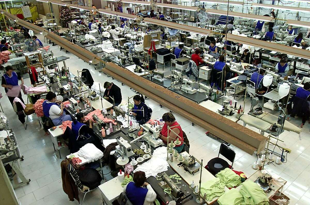 Seamstresses work on their sewing machines at the Camen's Confections clothing factory Wednesday, Dec. 26, 2003, in Guadalajara City, Mexico. Camen make clothing for Wal-Mart and Sams Club. As the North American Free Trade Agreement turns 10 on Jan. 1, 2004, supporters and detractors are engaged in a heated debate about the future of the precedent-setting commerce treaty as well as its impact on free trade in the Americas and around the globe.(AP Photo/Guillermo Arias) In Guadalajara, operators sew clothing at Camen's Confections, a company that sells to Wal-Mart. A sailboat passes a container ship in busy Sydney Harbor. Australia and the United States may be close to a free trade agreement. A sailboat passes a container ship in busy Sydney Harbor. Australia and the United States may be close to a free trade agreement. also ran 02/26/2004 03/30/2004 As You Sow's Michael Passoff (left), Conrad MacKerron and Thomas Van Dyck at Urban Ore in Berkeley, which recycles computers. As You Sow's Michael Passoff (left), Conrad MacKerron and Thomas Van Dyck at Urban Ore in Berkeley, which recycles computers. Ran on: 09-19-2011 Controversial since it came into force in 1994, NAFTA sparked renewed debate on its 10th anniversary. Here, workers in Guadalajara City sew clothing for Walmart and Sam's Club just a few days before the decade mark.