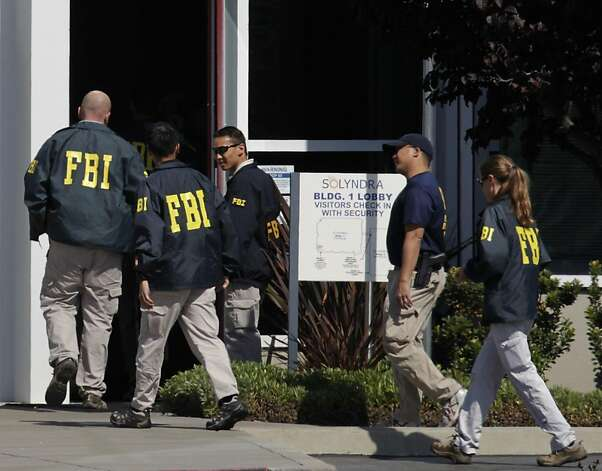 FBI agents enter the lobby of the Solyndra solar company offices after serving search warrants in Fremont, Calif. on Thursday, Sept. 8, 2011. Last week, Solyndra laid off all of its 1,100 employees after filing for bankruptcy.  Ran on: 09-09-2011 FBI agents enter the Solyndra solar company offices in Fremont after serving search warrants. Last week, Solyndra laid off 1,100 employees and later declared bankruptcy. Photo: Paul Chinn, The Chronicle