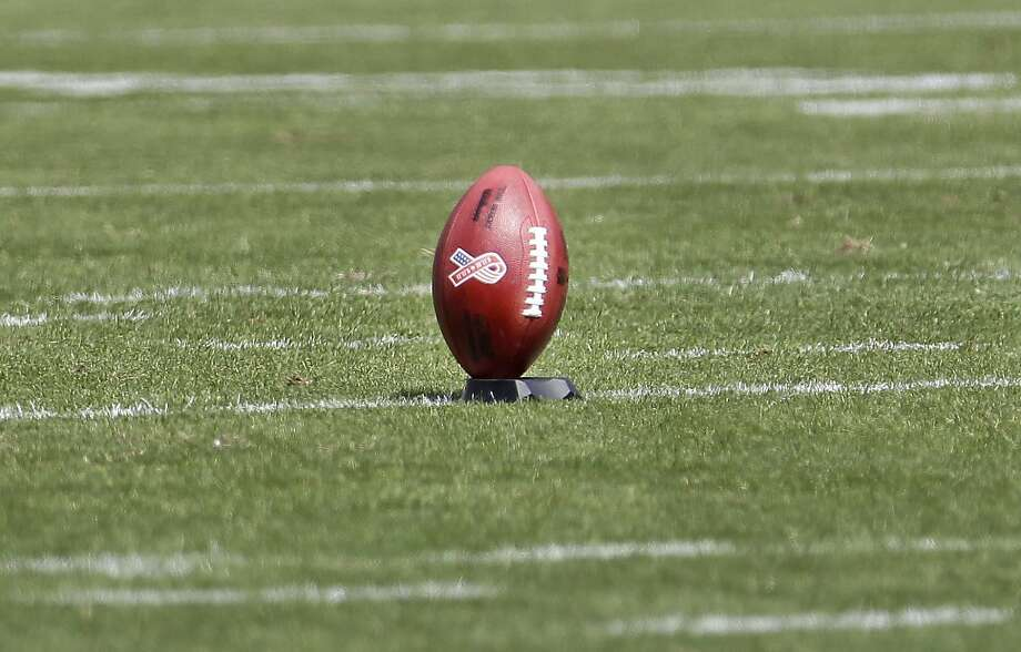 A 9/11 football is shown before San Francisco 49ers place kicker David Akers (2) kicked the opening kickoff against the Seattle Seahawks in an NFL football game in San Francisco, Sunday, Sept. 11, 2011. (AP Photo/Paul Sakuma) Photo: Paul Sakuma, AP