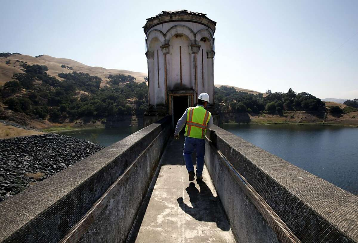 John Rocca, the construction manager from Black and Veatch Water, looks over the wall at the water intake system on the old dam on Alameda Creek in Fremont, Calif., Tuesday, September 13, 2011. Ground will be broken on Friday for a new earthen dam. The project is expected to take four years and will be more seismically secure than the current dam. The new dam will be behind the old dam, which will be partly submerged and partly removed to allow water through to the new dam.