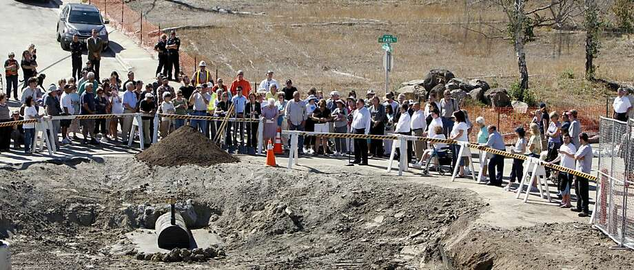 Residents of the San Bruno Crestmoor neighborhood stand with the Mayor and other officials at the corner of Glenview Drive and Earl for a   ceremonial shoveling  of dirt to start  filling  the crater which was created by the PG&E pipeline explosion, Tuesday September 20, 2011, in San Bruno, Calif. Photo: Lacy Atkins, The Chronicle