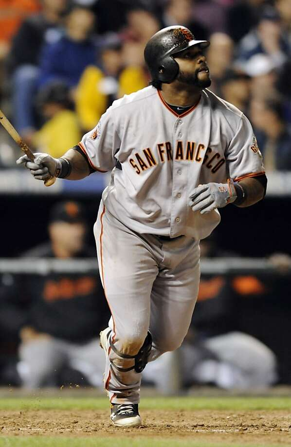 San Francisco Giants' Pablo Sandoval watches his triple off Colorado Rockies starting pitcher Jhoulys Chacin during the sixth inning of a baseball game Thursday, Sept. 15, 2011, in Denver. (AP Photo/Jack Dempsey) Photo: Jack Dempsey, AP