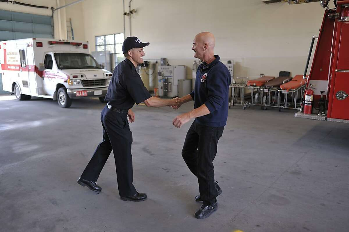 Dennis Brody, now retired, was a firefighter with the city of Alameda and has suffered for years with severe tinnitus. He still occasionally visits the Station 4, where he spent most of his time. Here he greets Eddie Dutch-Storey (yes), one of the paramedics at the station.