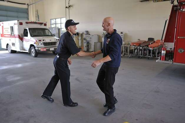 Dennis Brody, now retired, was a firefighter with the city of Alameda and has suffered for years with severe tinnitus. He still occasionally visits the Station 4, where he spent most of his time. Here he greets Eddie Dutch-Storey (yes), one of the paramedics at the station. Photo: Special To The Chronicle