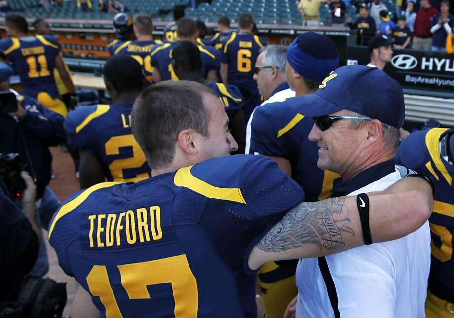 University of California head coach Jeff Tedford is greeted by his son Quinn Tedford (17) after Tedford won his 75th game gainst the Presbyterian Blue Hose Saturday September 17, 2011 at AT&T Park in San Francisco California 63-12. Photo: Lance Iversen, The Chronicle