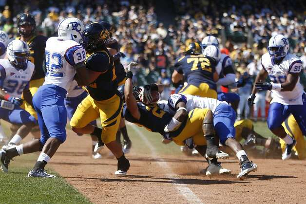 University of California Golden Bears tailback Isi Sofele is tackled across the goal line by Presbyterian Blue Hose safety Justin Bethel, at AT&T Park in San Francisco, Calif., Saturday, Sept. 17, 2011.  The play resulted in a touchdown. Photo: Dylan Entelis, The Chronicle