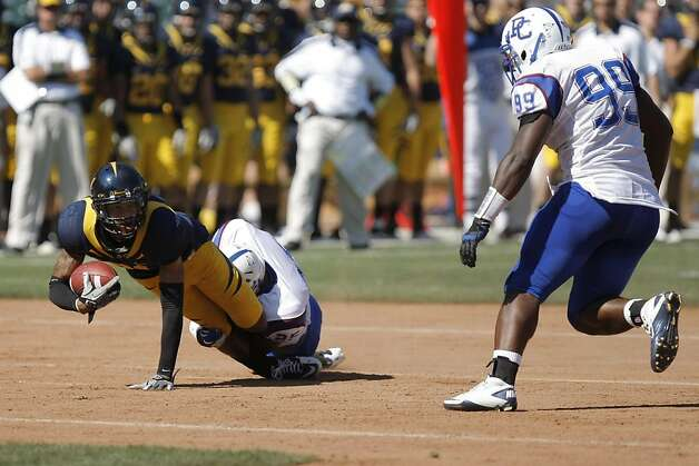 A University of California Golden Bears receiver stretches for more yards against the Presbyterian Blue Hose, at AT&T Park in San Francisco, Calif., Saturday, Sept. 17, 2011. Photo: Dylan Entelis, The Chronicle