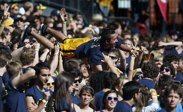 University of California students celebrate a second quarter touchdown by doing push-up's during their game with the Presbyterian Blue Hose Saturday September 17, 2011 at AT&T Park in San Francisco California. Photo: Lance Iversen, The Chronicle