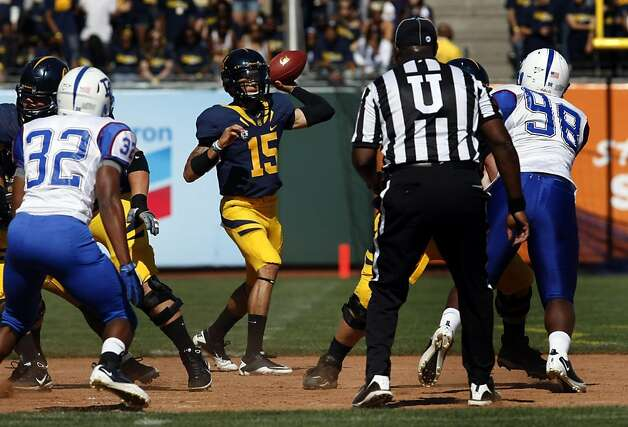 University of California QB Zach Maynard dives for a first down in the first half of their game with the Presbyterian Blue Hose Saturday September 17, 2011 at AT&T Park in San Francisco California. Cal won 63-12 Photo: Lance Iversen, The Chronicle